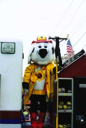 Myron on the fire truck in his fire dog outfit